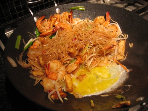 Adding egg to wok
