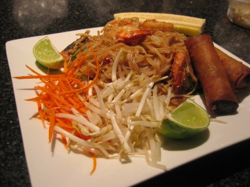 Traditional pad thai with spring rolls