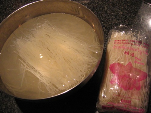 Rice sticks soaking in water